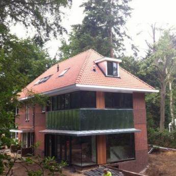 Woonhuis Bilthoven - Walsblank zink, staande fels